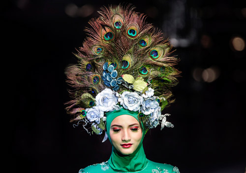 Aug 25 Fabulous headwear on show at Malaysia s Islamic Fashion Festival 8816ea965d3